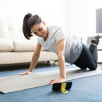 woman learning new exercises watching online workout tutorials